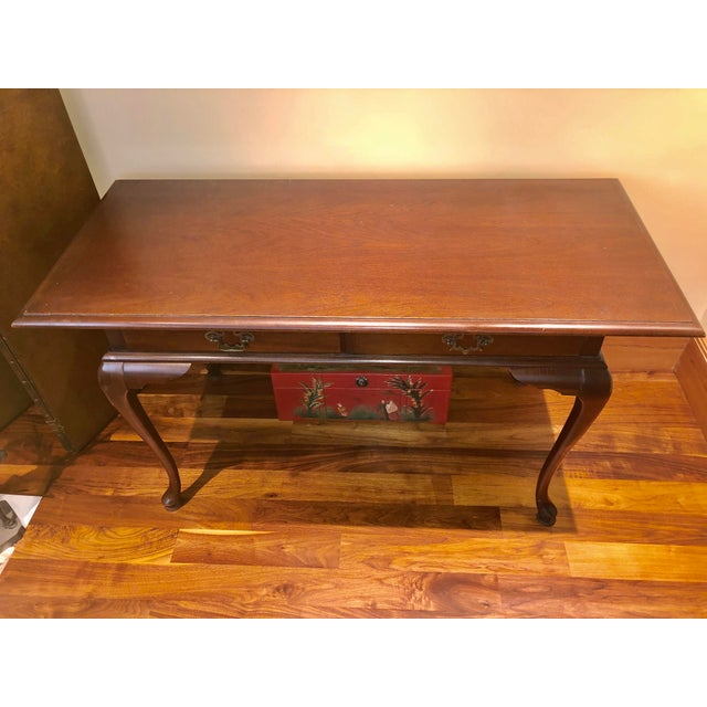 Functional queen and reproduction writing desk.