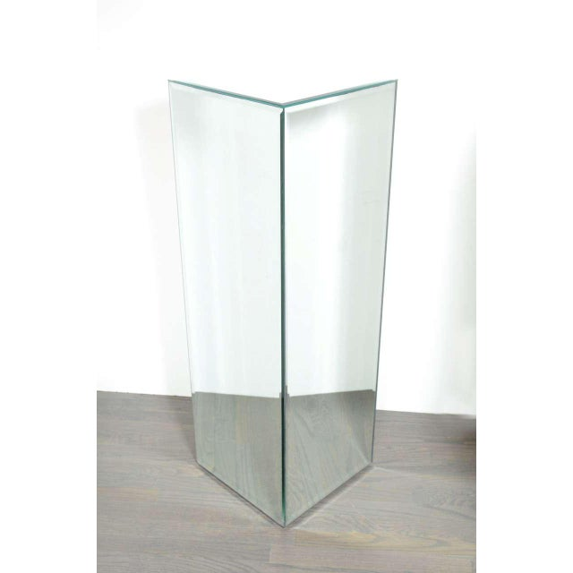 This pedestal is mirrored on all four sides and also the top. Each pane is hand beveled. It's perfect for displaying...