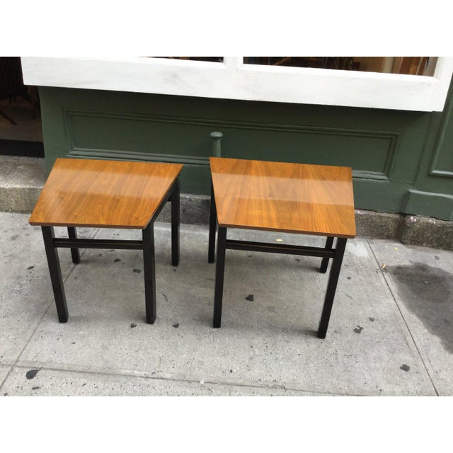 Pair of trapezoidal nesting tables.