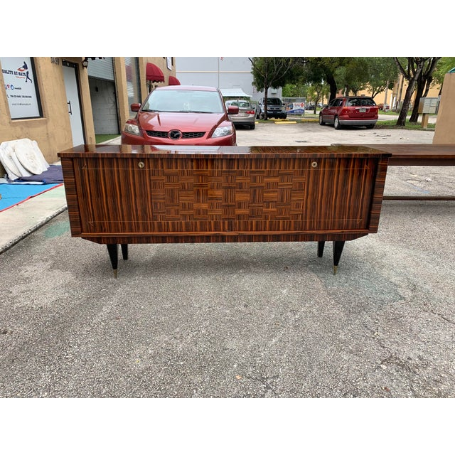 Classic French art deco exotic Macassar ebony sideboard/buffet , circa 1940s. The sideboard are in very good condition...