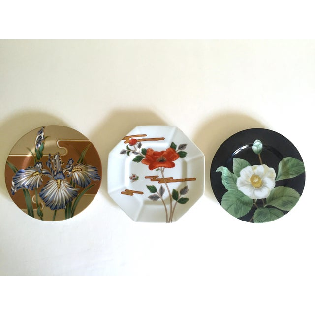 This set of three Fitz & Floyd Japan vintage Contemporary Modernist floral porcelain dessert plates are a very special and...