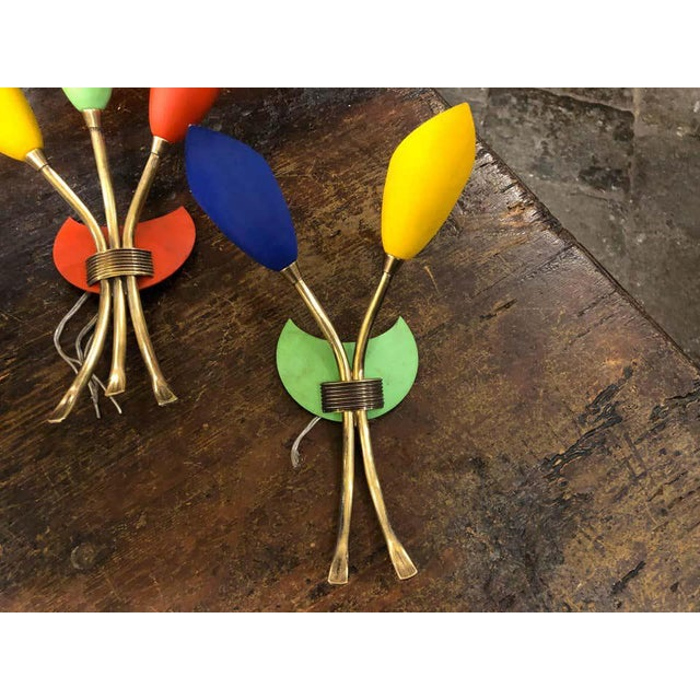 Three multicolored Sputnik Italian wall sconces in the manner of Arredoluce, fully restored electrical parts. Probably the...