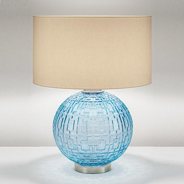 Aqua glass hand blown lamp with a geometric pattern on a brushed nickel base. Complete with linen shade. Certification:...