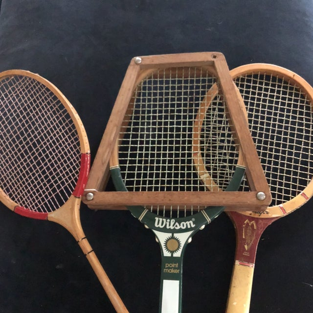 A collection of four antique tennis rackets which can hang beautifully over a mantel or wall.