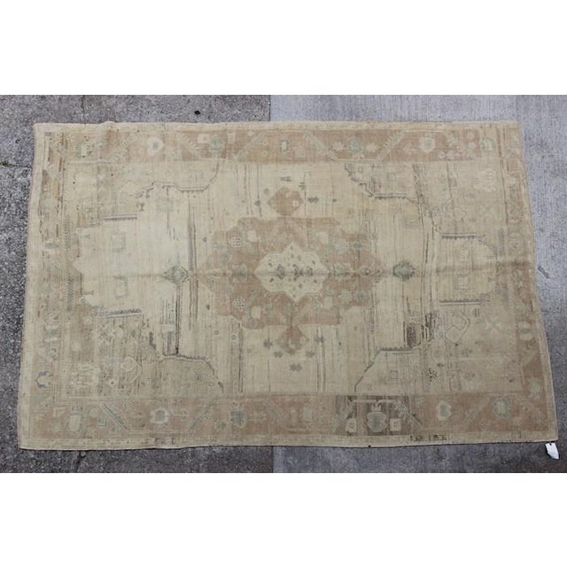This is a vintage Turkish rug that has a very faded and lovely design. The rug is a faded gold color. Each vintage...