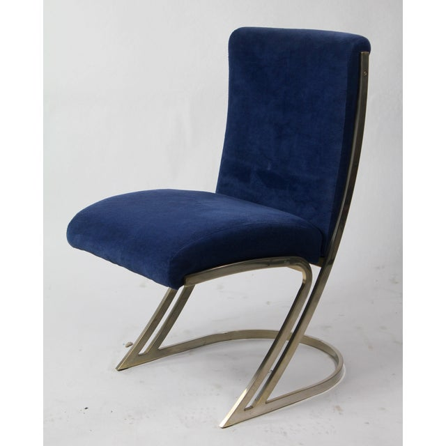 Selling is very cool mid-century modern dining chairs in the style of Milo Baughman with a chrome base and velvet...