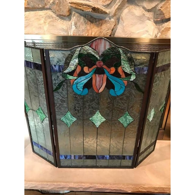 Stained glass fire screen having three beautiful panels of floral motif.