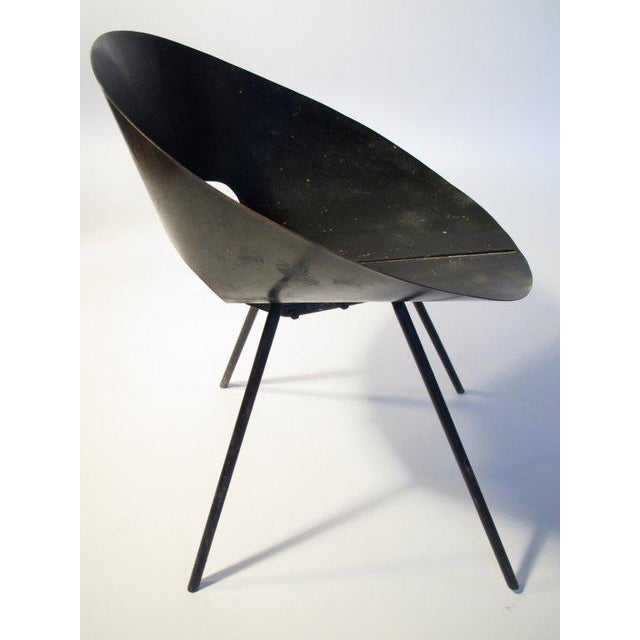 A rare chair by Donald Knorr for Knoll. Great modernist design, bent sheet metal with solid rod steel legs. Model # 132...