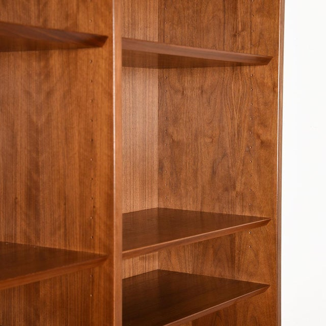 Adjustable Beveled Walnut Shelves Throughout. Two Middle Shelves (One on Each Side), are stationary. Please note:...