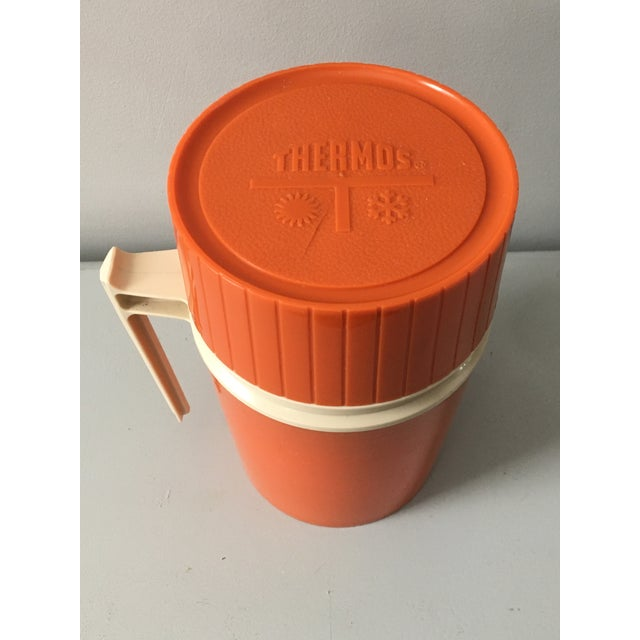 A classic piece from the American Thermos Bottle company in Norwich, Conn., this 1960s camping orange/tan 10oz thermos is...