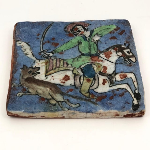 I find this antique Persian tile so beautiful. That blue. That green. That crooked elbow and hand, and that sword! These...