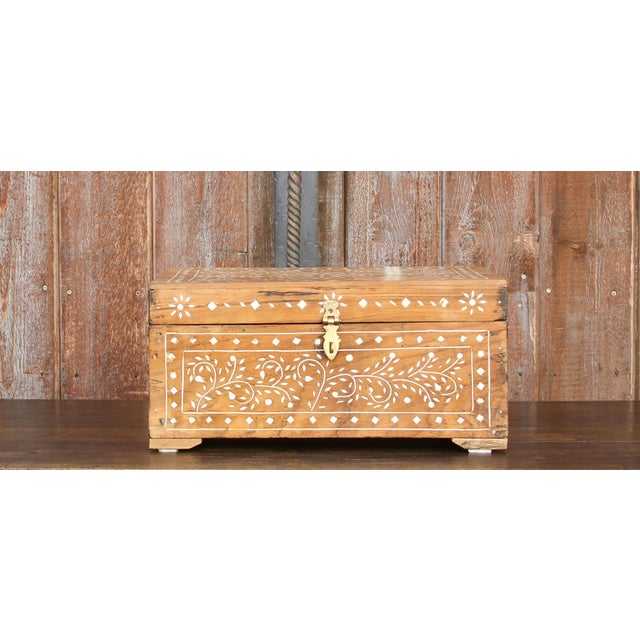 A lovely British colonial box with scroll leaf and flower inlaid designs and added brass hardware, this chest opens wide...