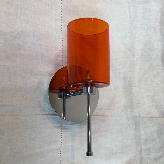 Axolight Spillray Wall Sconce in Red - Showroom Sample Wall sconce with a chrome finished base and a red cylindrical pyrex...