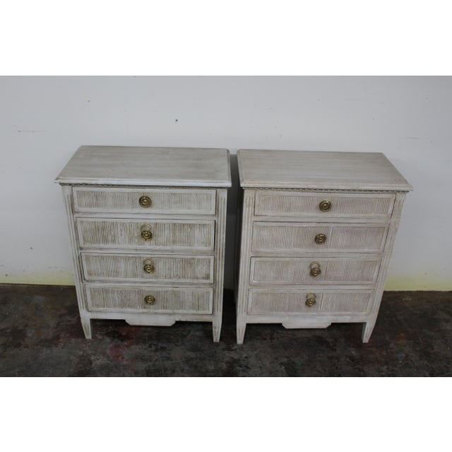 Vintage Gustavian style nightstands made of solid oak wood and feature four spacious drawers and tapered block legs....