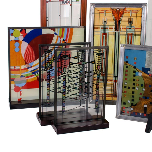 Set of 8 Frank Lloyd Wright replica stained glass panels. Authorized by the Frank Lloyd Wright Foundation these panels are...
