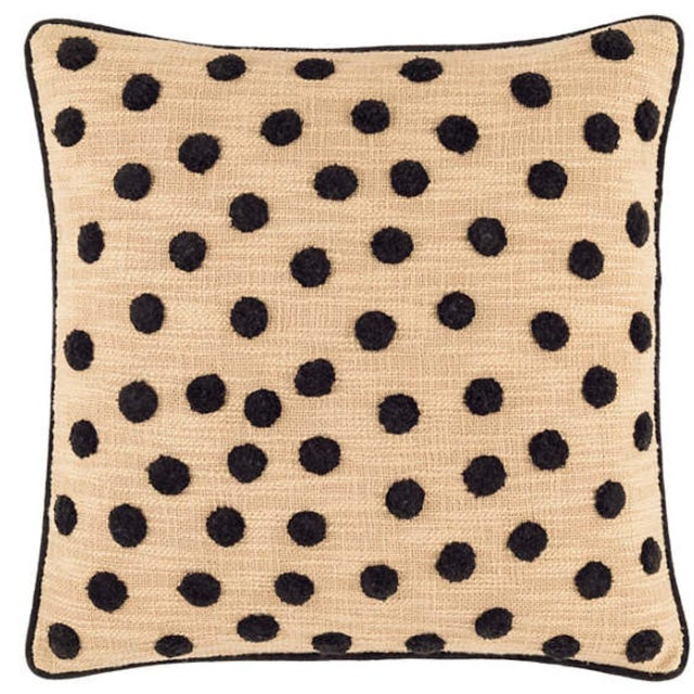 "This 20"" pillow is decorated with black plush pom-pom dots on a textural slubby light kahki handwoven cloth and framed..."