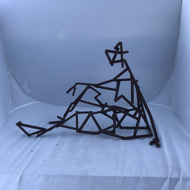 An geometric abstract sculpture executed in square stock iron attributed to Moria Fain. This piece is substantial openness...