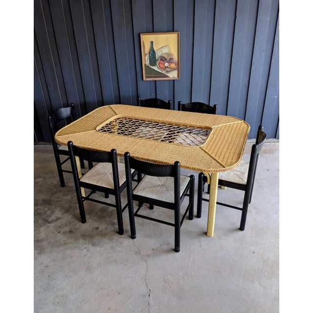 Excellent condition dining table by Henry Link. Sturdy and heavyweight all wood construction, wrapped in wicker with...
