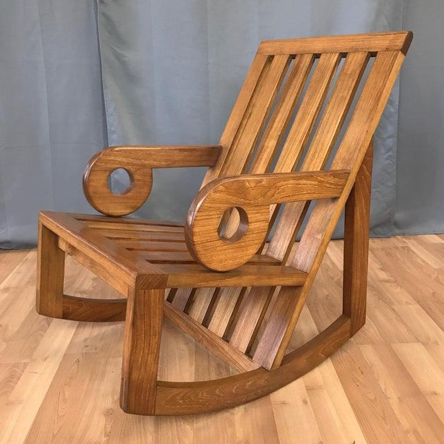 An early and rare AP288 Aperture rocker in teak by Monterey, California, designer, architect, and artist Kipp Stewart for...