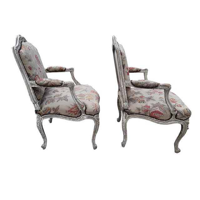 Charming country pair of antique French bergeres/armchairs. Classic French carved frames finished in traditional French...
