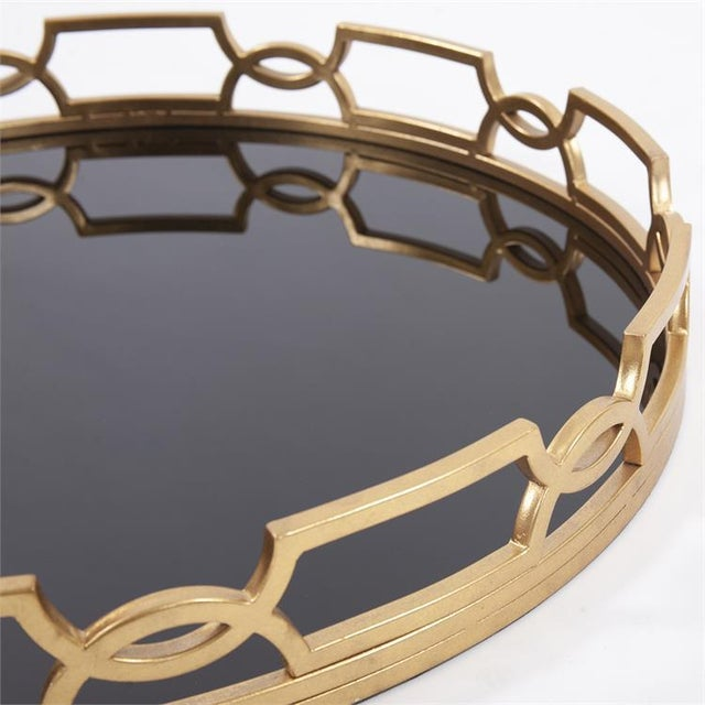 The Kyron Round Tray has a black mirror surface that contrasts beautifully with the luster of the ornate gold frame. The...