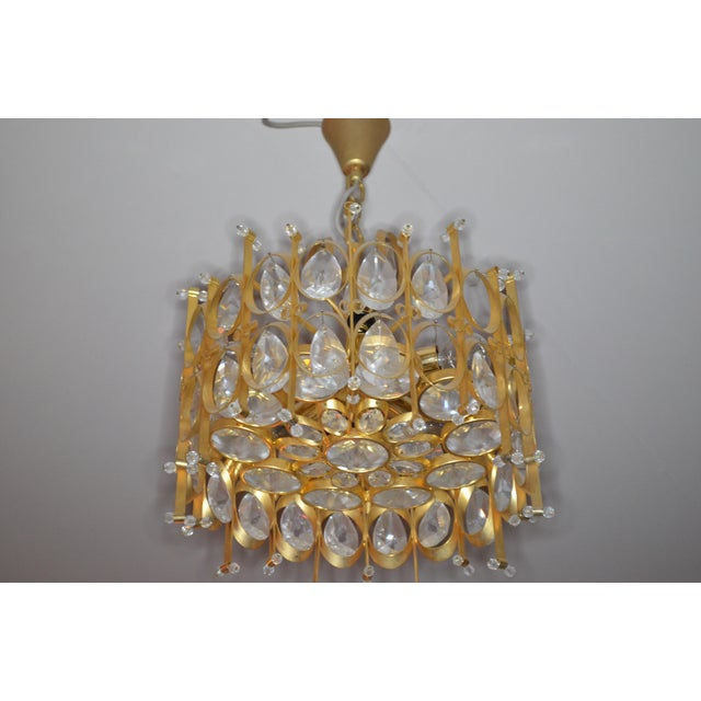 Vintage Hollywood Regency gold plated gilt brass 5 lite prism crystal chandelier in the style of Gaetano Scilari for...