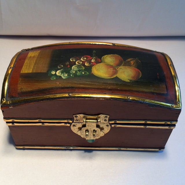 Beautiful vintage wooden box with fruit hand painted on the top. Brass detail surrounding edges and brass latch with brass...