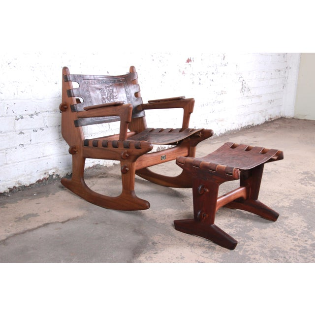 A gorgeous Ecuadorian rocking chair and ottoman by Angel Pazmino for Muebles de Estilo. The set features solid teak wood...