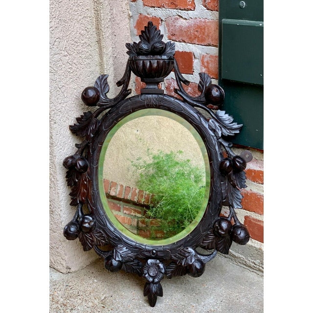 19th Century Antique English Black Forest Style Carved Dark Oak Oval Wall Mirror For Sale - Image 13 of 13