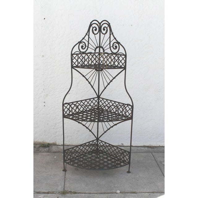 This early Spanish iron corner shelf is in great condition. The iron corner shelf has such great details and design. This...