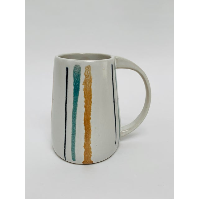 Rare mug from Bennington Potters circa. 1960s.The mug features a unique oval design that tapers upward from the bottom.The...