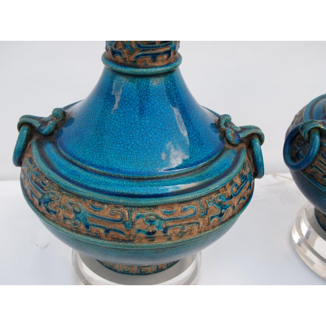 Pair of Asian inspired Italian Ceramic Mid-Century Turquoise Lamps in a crackle glaze. Expertly mounted on double stacked...