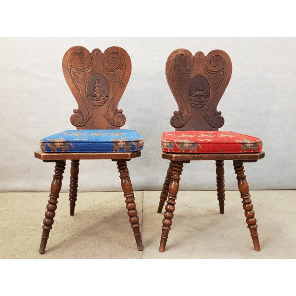 This delightful pair of alpine peasant chairs has traditionally carved backs. The style reminiscent of the French Alp...