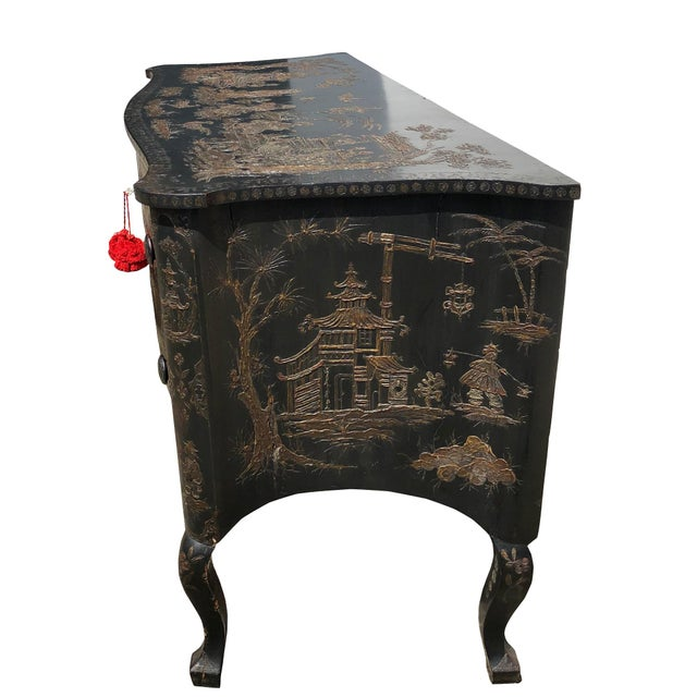 A fine and very rare Italian 18th Century two drawer chest decorated in a black and gold Japanned surface. The images are...