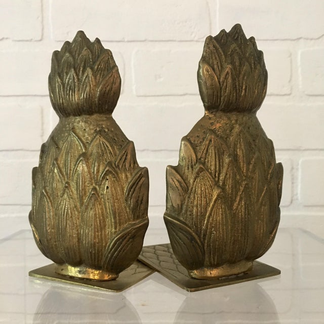 "Pair of Mid-century brass pineapple bookends. Each bookend measures 6"" tall, 4"" wide, 4""deep. Minor wear and patina..."