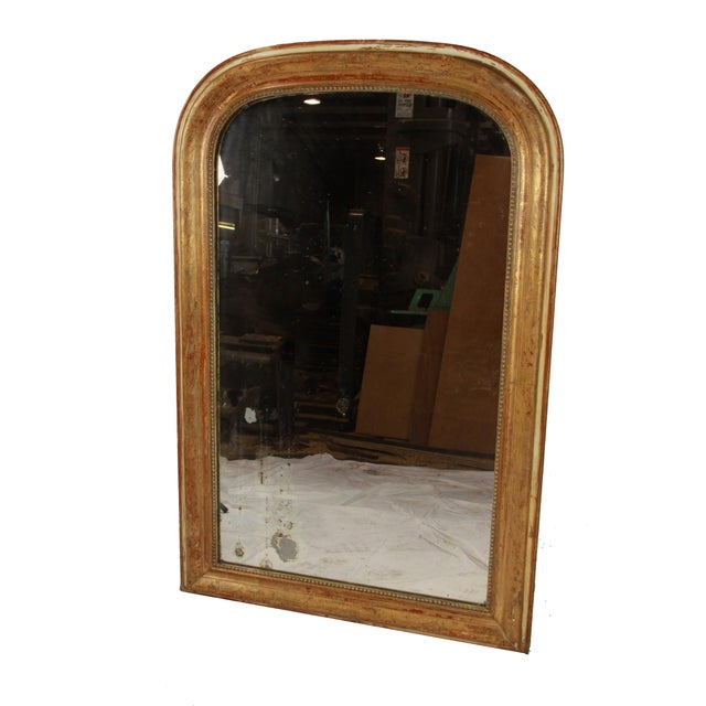 Exquisite French Louis Philippe mirror, circa 1880. The frame is wood with a brilliant gilt finish slightly worn away to...