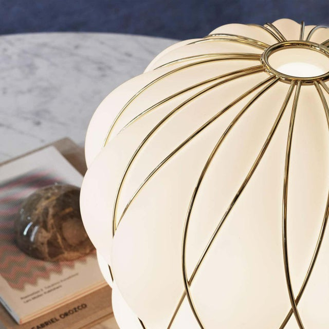 Medium 'Pinecone' table lamp in opaline glass & gold metal for Fontana Arte. Designed by Paola Navone, the Pinecone comes...