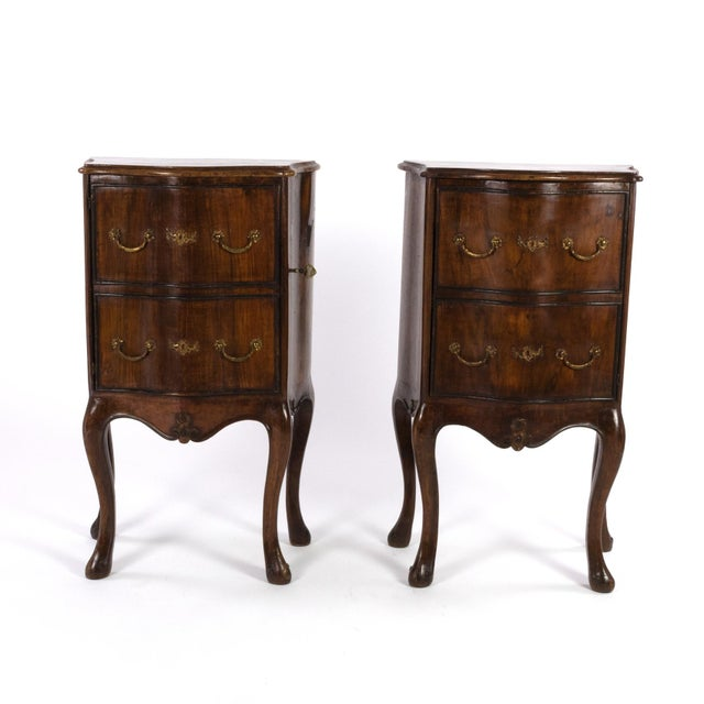 Pair of Italian walnut bedside tables with carved and ebonized details, each with faux drawer front single doors, circa...