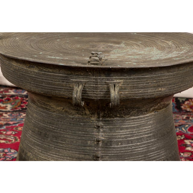Circular with concentric circles on the top and curved sides decorated with geometric motifs. The top with four pierced...