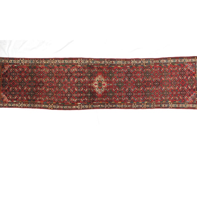 Wool pile hand made vintage Persian Hamadan runner in excellent condition.