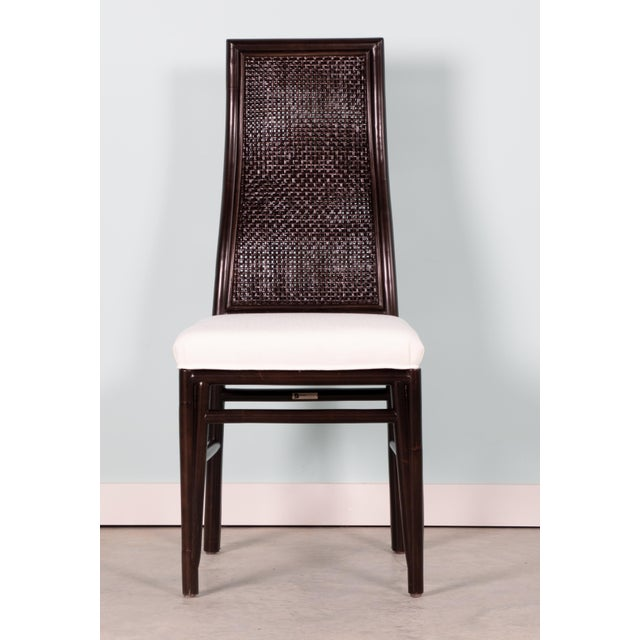 This David Francis dining chair set features a rattan frame with a double walled open cane seat back. The cushion is a...