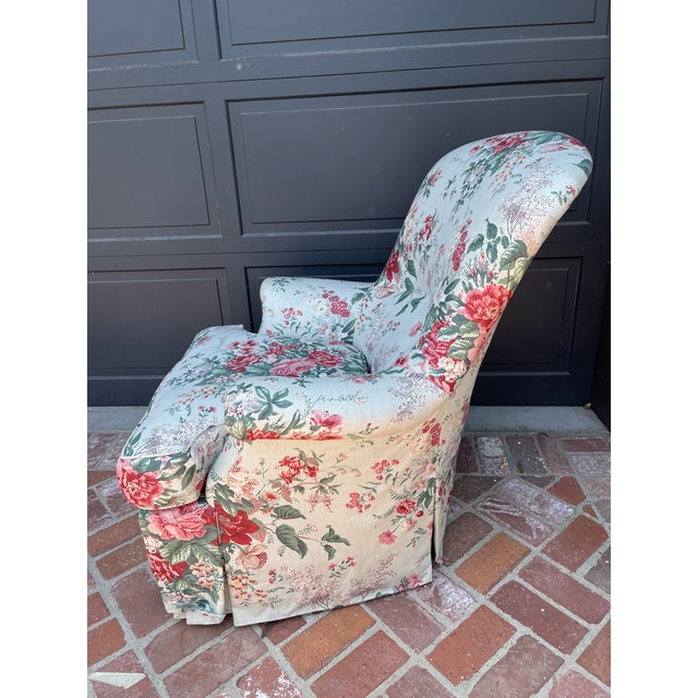 1980's arm chair in chintz fabric with rolled arms and a skirt. Deep comfortable seat to cozy up with a book or drink!