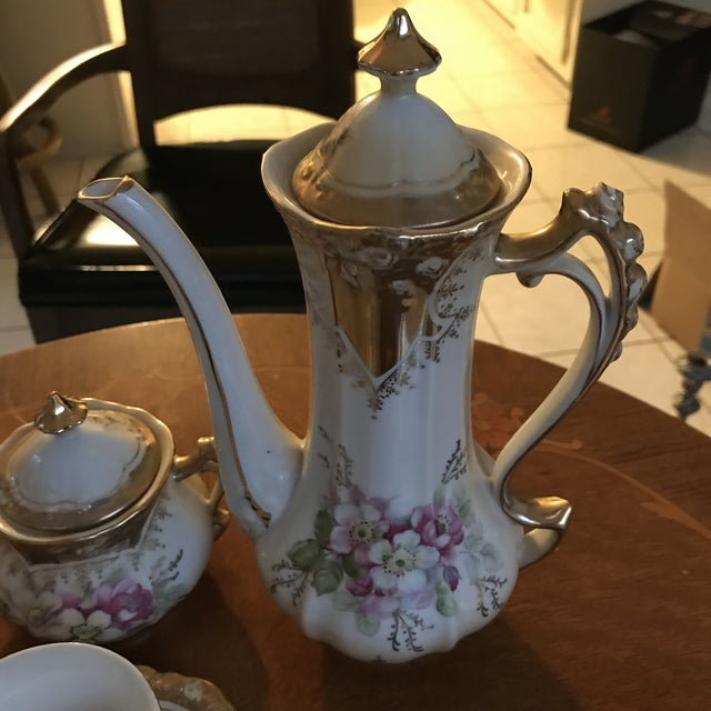 This is a truly lovely chocolate pot set with heavy gold details and lovely pink flowers all over. The underside has the...