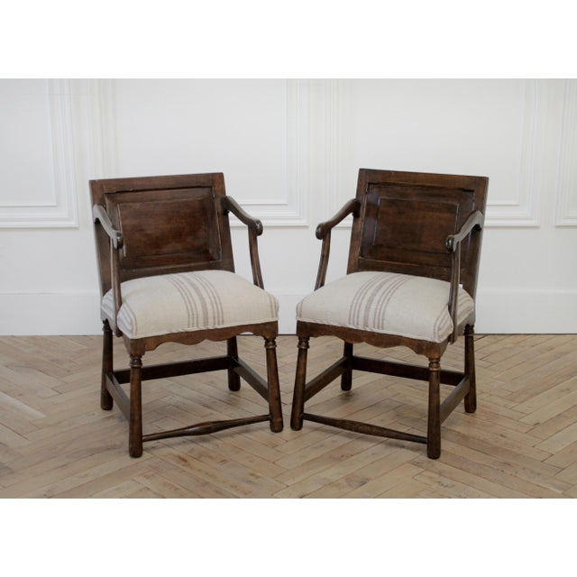 Pair of Fruitwood Carved and Upholstered Arm Chairs SKU Number: 7041-993299 Description: Pair of Fruitwood Carved and...