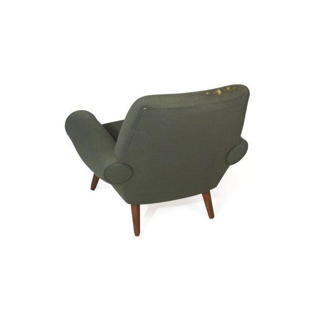 Scandinavian midcentury upholstered lounge chair designed by Kurt Ostervig for Ryesberg Moblefabrik, Model 14. Upholstered...