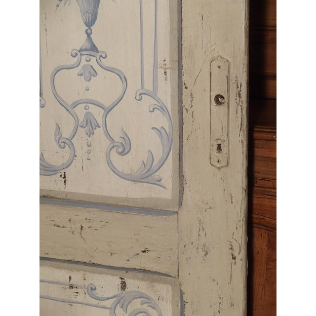 This paneled and double-sided interior door was hand painted in Lombardy, Italy around 1850. Both sides have the same...