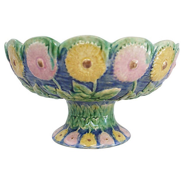 19th-century Etruscan majolica pottery pedestal bowl with floral exterior motif and muted pink interior. Griffon, Smith &...