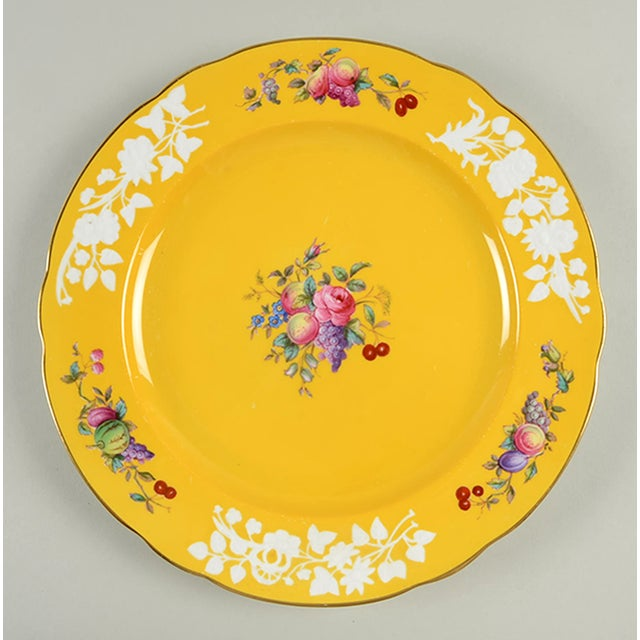 Spode #R9058 Dinner Plate S/6 features white raised floral sprays and multicolor fruit and flowers on a rich yellow base...