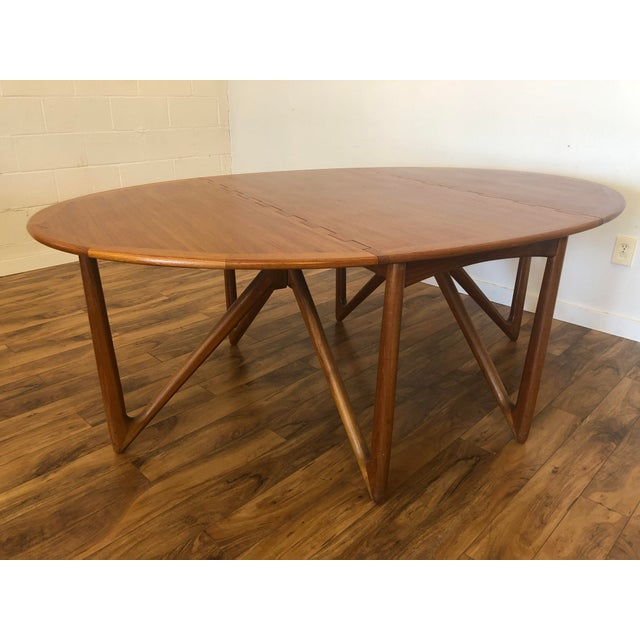 Stunning Danish teak gate leg dining table by Niels Koefoed for Koefoed Hornslet circa early 1960's, often attributed to...