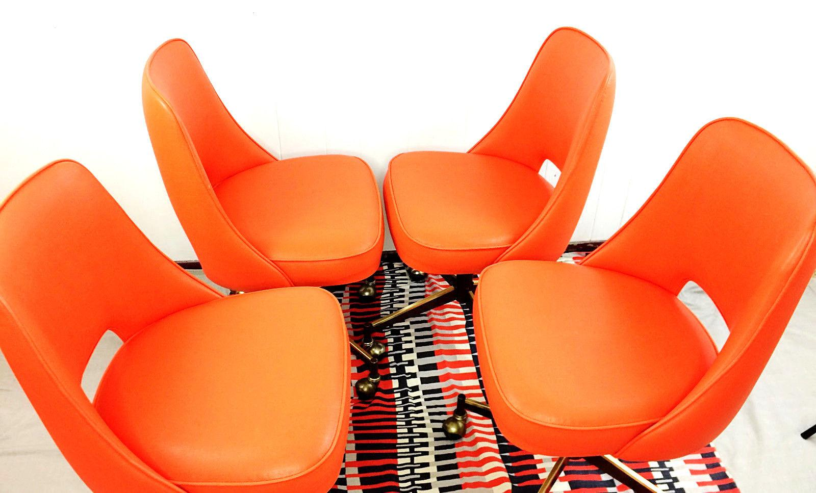 Mid Century Modern Orange Vinyl Rolling Bucket Dining Chairs   Set Of 4    Image
